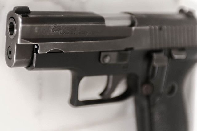 Sig Sauer P6 - West German Police model, single stack, 9mm semi-automatic pistol.