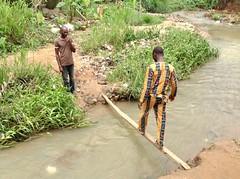 Crossings a flowing river, Ushafa Village, Abuja, Nigeria, #JujuFilms