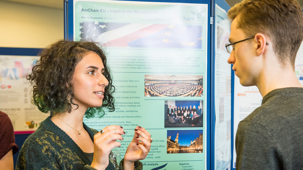 Two students talking at a placement poster event