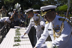 Capt. Hank Kim, U.S. Naval Forces Korea chief of staff, and Capt. Kwang Lee lay flowers at the Gen. Douglas MacArthur Statue in Incheon, Sept. 15. (U.S. Navy/MCSN William Carlisle)