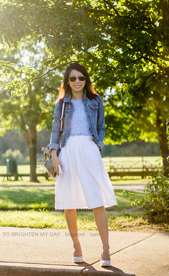 denim jacket, baby blue eyelet scalloped crop top, white clip dot midi skirt, gray tote with navy striped strap, striped espadrille wedges