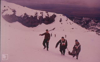 Ski patrol with stretcher and shovel. Mt Ruapehu, NZ. North Island, 1956