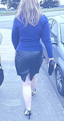Pretty Woman Walking Down the Street (in a Leather Skirt & High Heels)