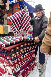 Poncho Vendor at the Otavalo Market, Ecuador