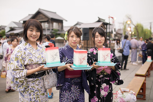 Mother and daughters in yukata holding Toro Nagashi paper products