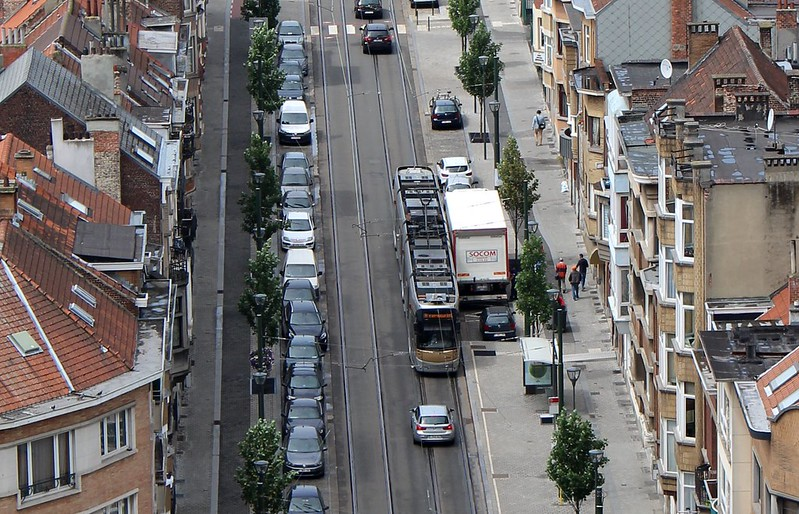 Brussels tram slowly makes its way past a truck parked too close to tracks
