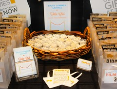 The New York Times Film Club and Pipsnacks table display closeup.