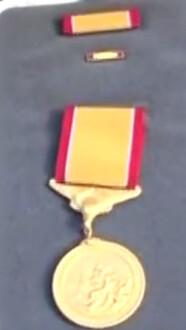 Coast Guard gold lifesaving medal closeup