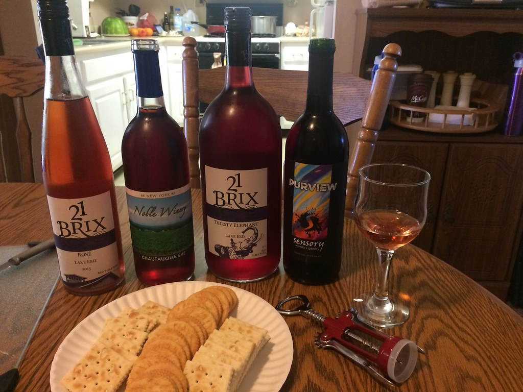 21 Brix Rosé, Noble Winery Chataqua Eve, 21 Brix Thirsty Elephant and Sensory Winery Purview with glass of 21 Brix Rosé