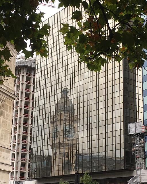 Gare de Lyon: clock tower reflected in modern building