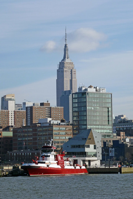 FDNY Fire rescue Ship & Empire State Building as seen from Circle Line Boat Trip around Manhattan Island in New York City, NY