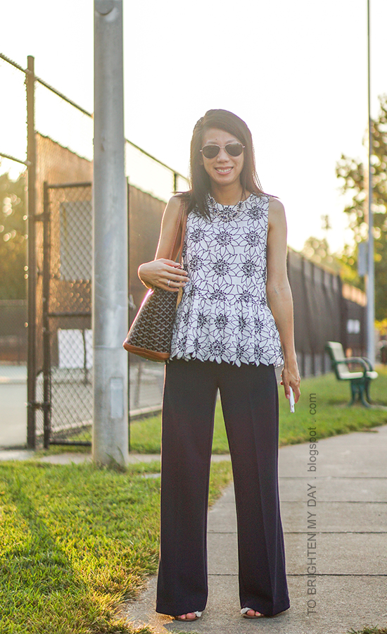 gemstone necklace, floral embroidered sleeveless top, navy wide-legged pants, white flats with embellishments, monogrammed tote