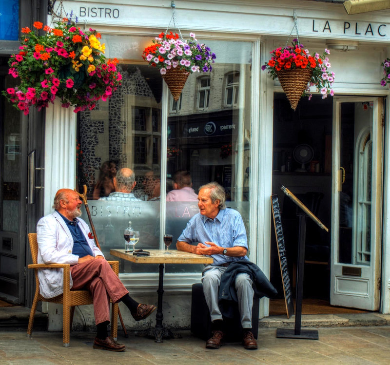 Time to talk over a glass of wine at La Place Bistro. Credit Neil Howard, flickr