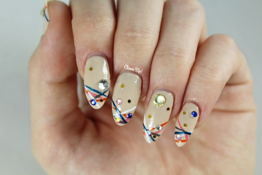Stripe nail art with rhinestone embellishments