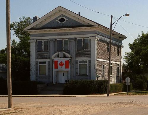 canada saskatchewan sk nokomis building bank tree parking flag prairie cameraphone 2017 thisdecade canadagood colour color green blue red white