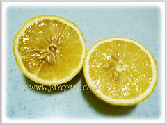 An opened Citrus limon (Lemon) with some seeds, 29 Aug 2017
