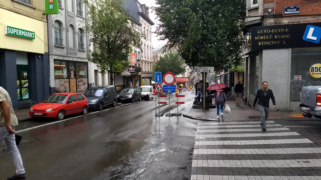 Walking to the Metro in the rain, Brussels