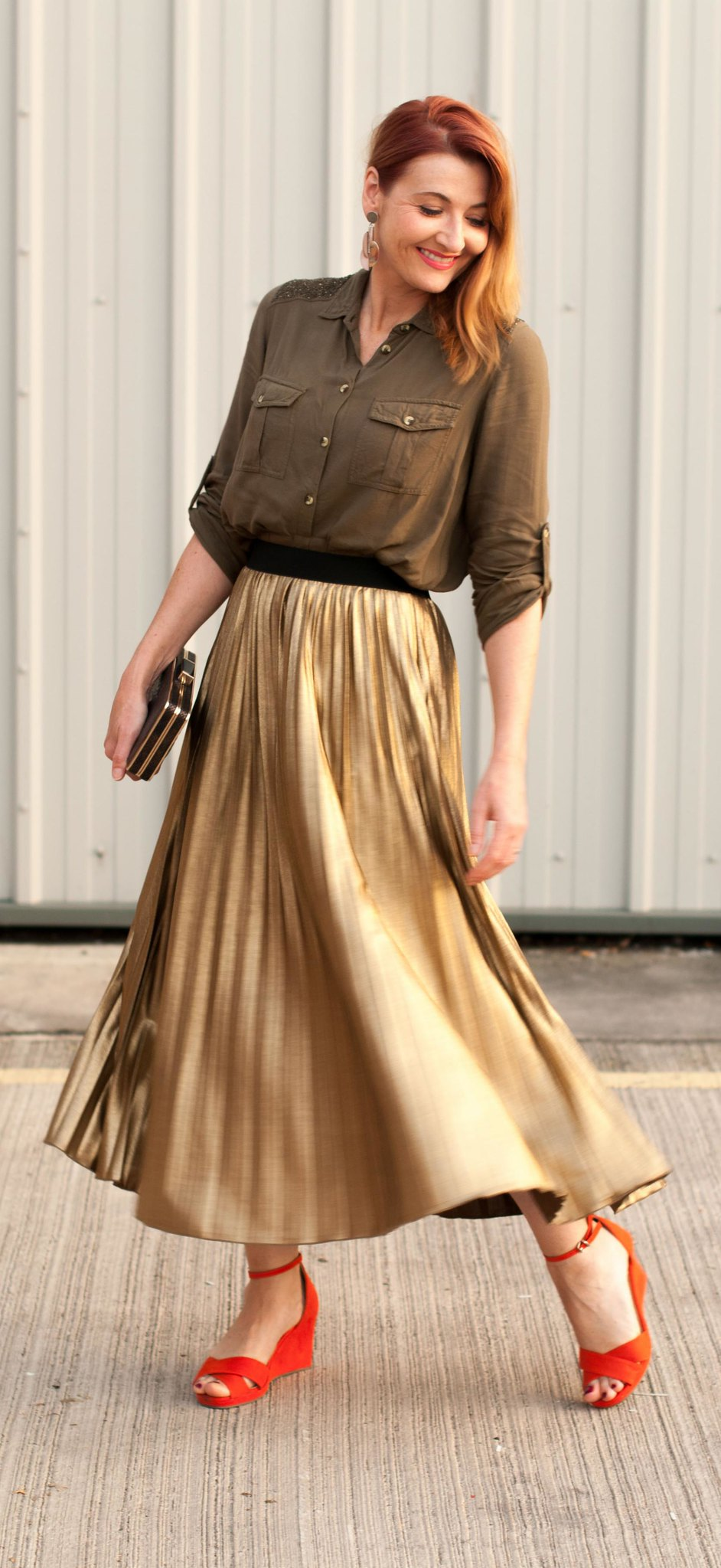 Date night outfit: Khaki soft shirt with embellished shoulders metallic gold pleated maxi skirt | orange-red wedge sandals metallic box clutch bag | Not Dressed As Lamb, over 40 style