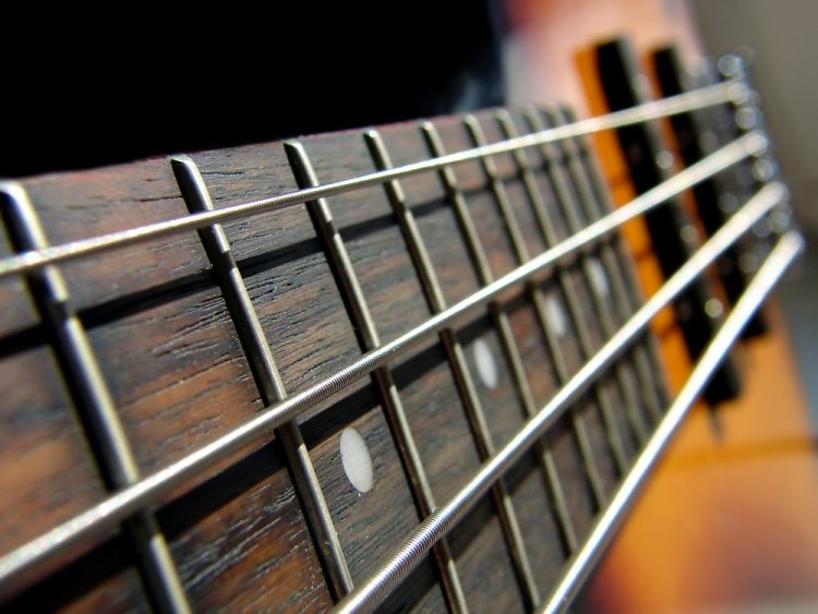 dramatic close-up photo of electric bass