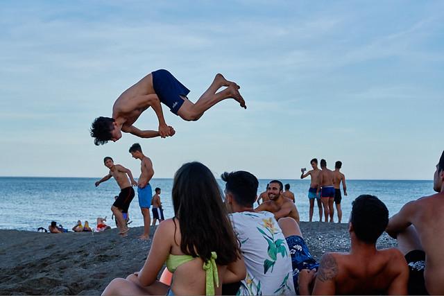 Young acrobats training on the beach, Pacífico barrio, Malaga, Spain