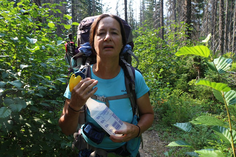 It's hot hiking uphill in the sun so Vicki deploys her awesome squirt bottle to cool off