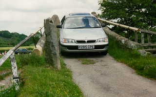 1997 Karen driving over Duck Bridge between North Yorkshire Visitor Centre and Danby Castle.