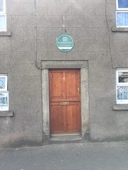 Photo of James Gleeson green plaque