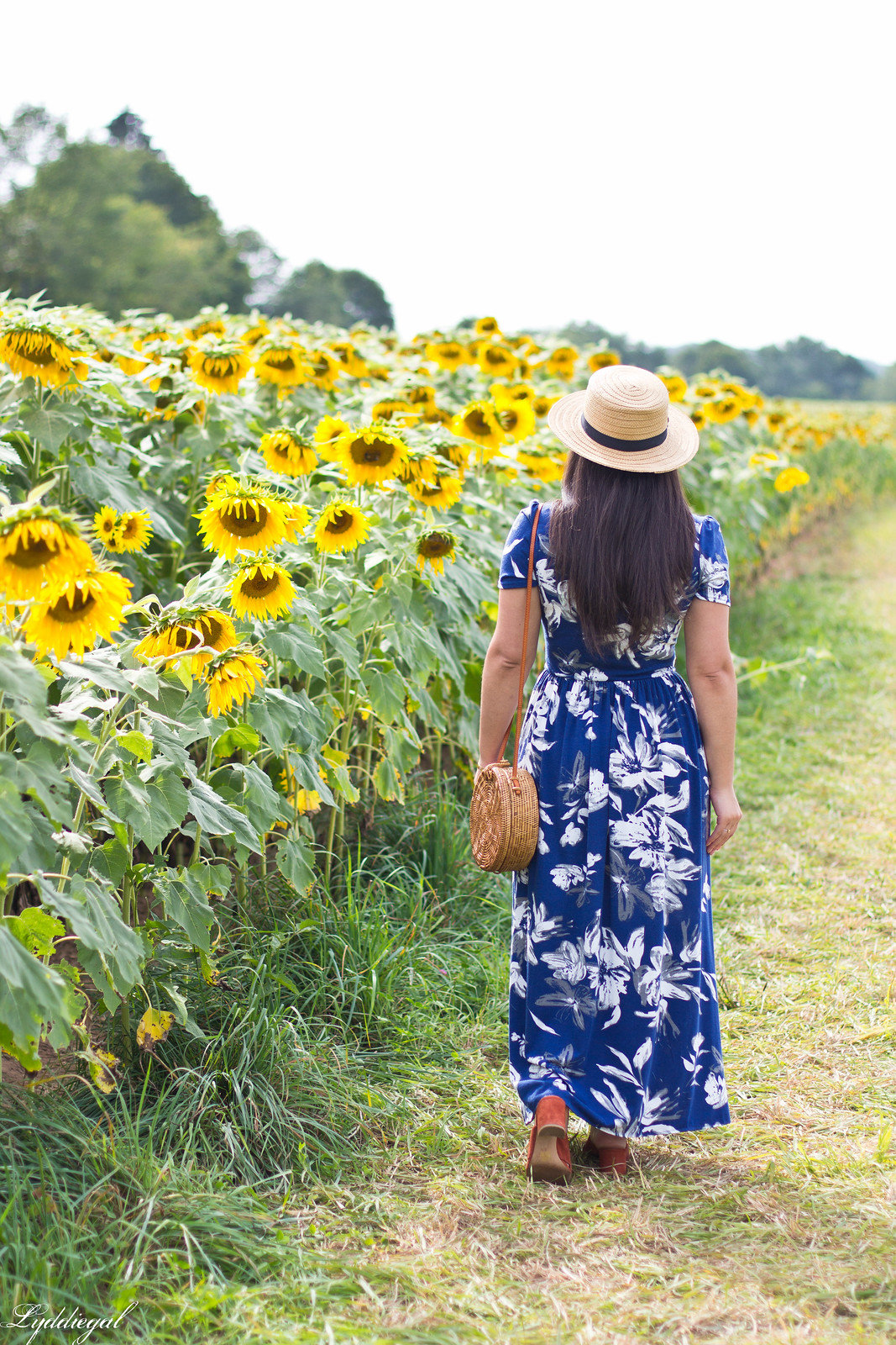 blue floral maxi dress, round rattan bag, straw hat, sunflower field-4
