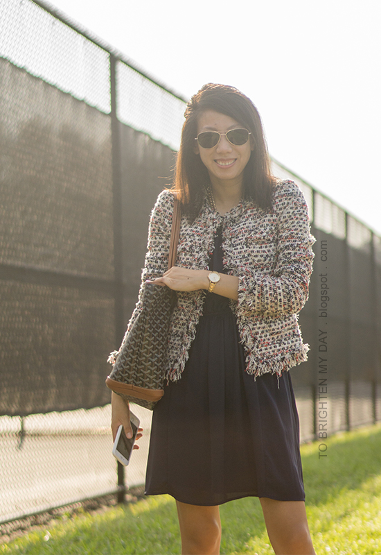 tweed jacket, navy pleated dress, gold watch, patterned tote