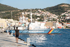 Frontex boat and immigrant in Samos, Greece