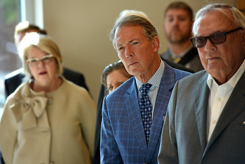 Board of Governors' Tom Fetzer (center) listens about nonwovens while touring Centennial Campus.