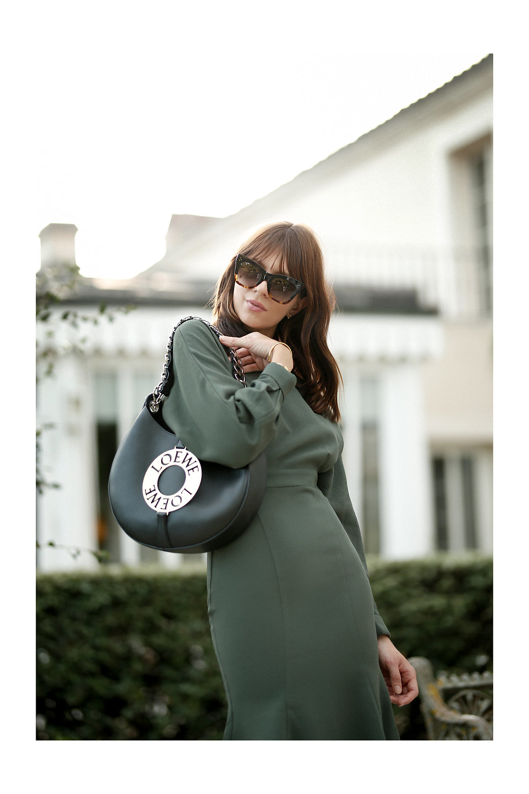 outfit green dress loewe joyce bag breuninger celine sunglasses les sources de caudalie france bordeaux late summer look going out dinner style hermes oran sandals brown minimal french chic parisienne bangs brunette france cats & dogs fashion blogger 4