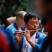 A Japanese Man Plays The Flute During A Shishimai Ceremony