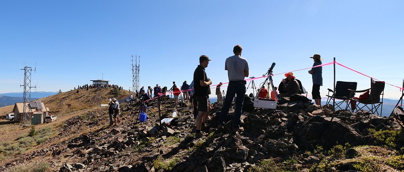 Panorama shot of solar eclipse viewers up on the Dixie Butte summit - only 15 minutes left until totality