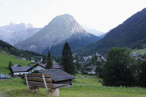 view of bench with alps in background