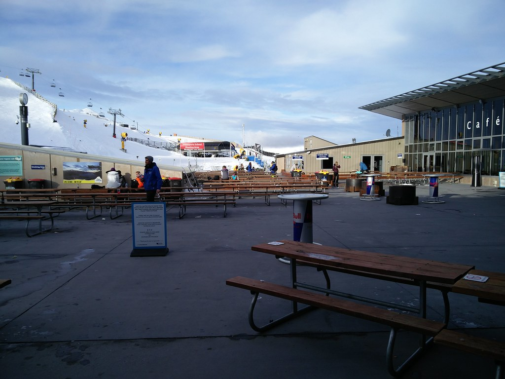 Outdoor seating at the base