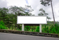 Blank billboard on mountain road