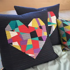 I sure Jefe will be thrilled with the new Heart pillows in the bedroom. #splitpersonalityquiltblock #sewkatiedidworkshops #crazypiecing