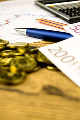 calculator,pencil and money on graffica the Dow Jones