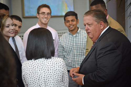 Board of Governors' Randy Ramsey (left) chats with Institute of Advanced Analytics students while touring Centennial Campus.