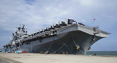 USS America (LHA 6) sits along the pier at Changi Naval Base in Singapore, Aug. 6. (U.S. Navy/MC2 Kristina Young)