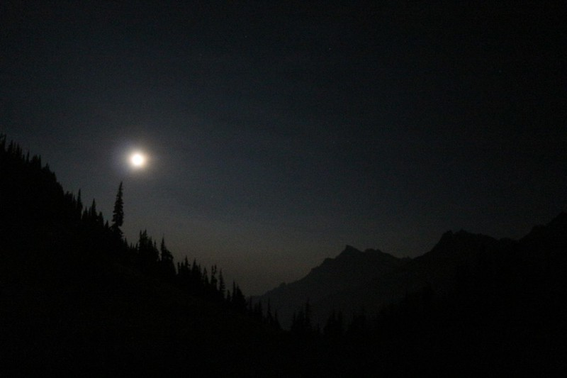 The gibbous moon rising in the night at Buck Creek Pass