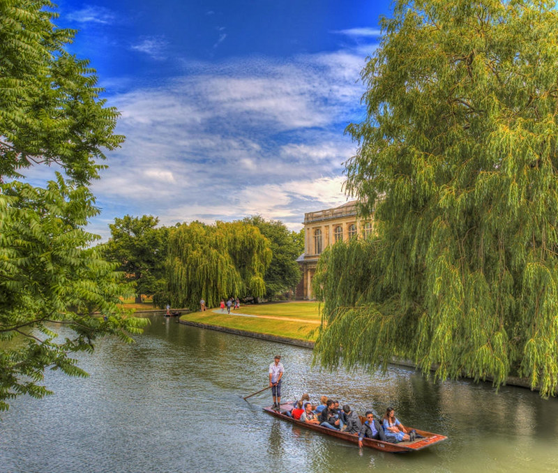 Punting past Trinity College Wren Library. Credit Scudamore's Punting Cambridge, flickr
