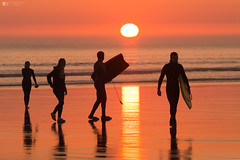 Surfers looking back