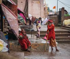 Indian people sitting on Ganges riverbank