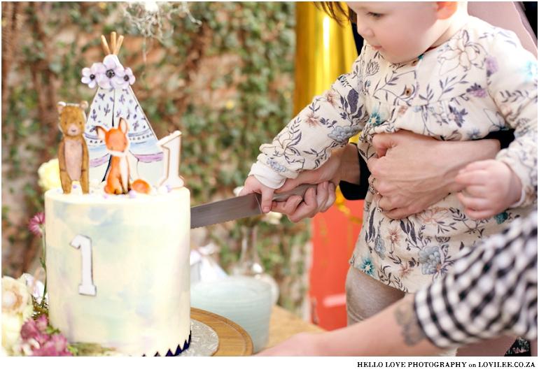 Fox Birthday party 'Wild One&#x27 cutting the cake