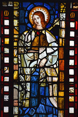 Composite figure of a female Saint (14th, 15th and 19th Century glass)
