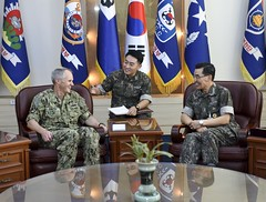 Vice Adm. Phil Sawyer speaks with Vice Adm. Jung, Jin-Sup during an office call, Sept. 14. (U.S. Navy/MCSN William Carlisle)