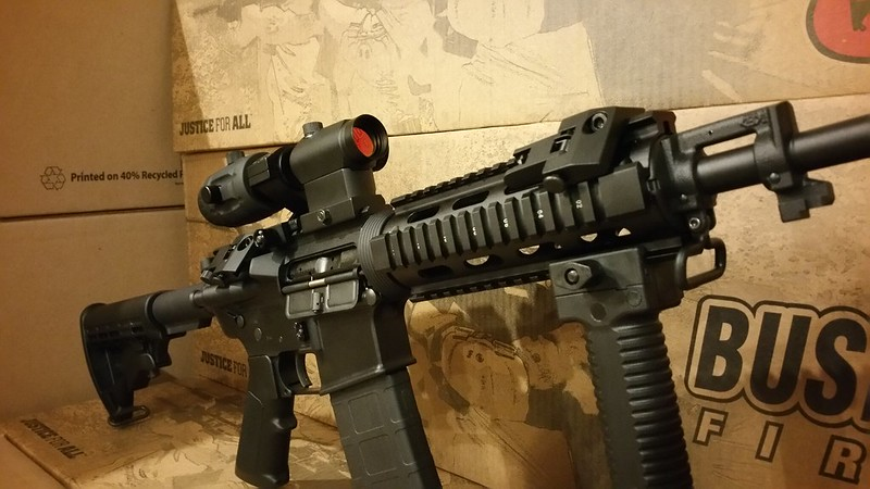 Bushmaster with 3x magnifier red dot and 45 degree sights WWW.USAFIREARMS.COM