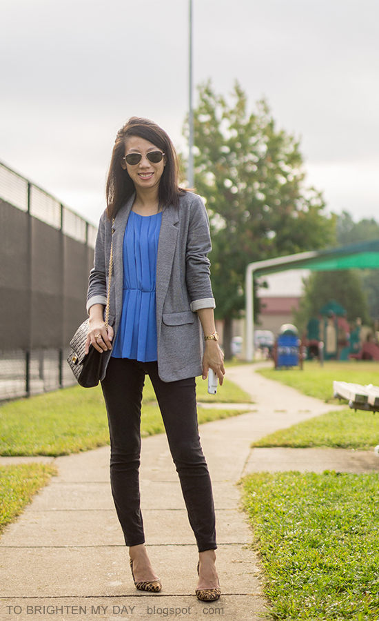 gray boyfriend blazer, bright blue pleated top, gold watch, black shoulder bag, black skinny pants, leopard pumps